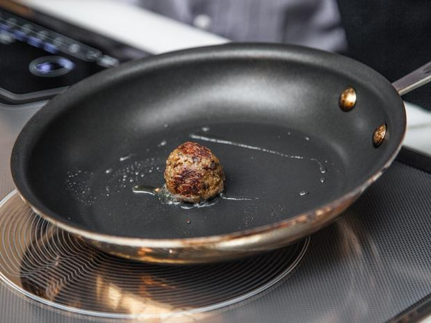 Memphis Meats lab-grown beef meatball in a frying pan