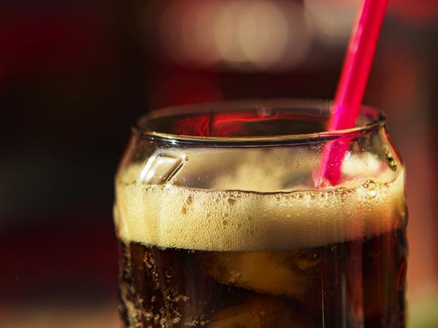 fizzy carbonated cola with straw co2