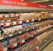 Bacon and sausages feature, chilled uncooked meat aisle