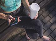 girl on phone drinking coffee starbucks