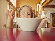 child eating cereal breakfast