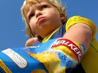 child eating crisps