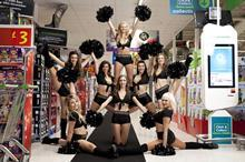 CHEERLEADERS: Cheerleaders entertain the crowds at the Asda Wembley store as they queue to get their hands on exclusive deals this Black Friday