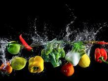 Fruit and veg splashing in water