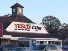 Tesco sign with Christmas hat