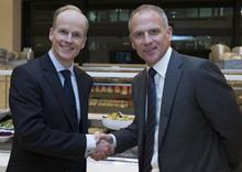 Booker CEO Charles Wilson (left) and Tesco CEO Dave Lewis