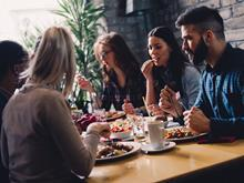 Young people eating and talking in a casual dining restaurant