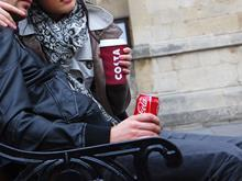 Man and woman drinking Costa Cofee and Coca-Cola