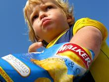 child eating crisps