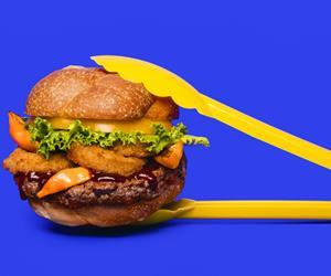 Impossible Foods plant-based vegan Impossible burger lifestyle shot with tongs