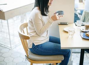 Young woman sitting at a desk at work