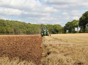tractor farming ploughing field