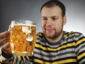 man with pint of beer