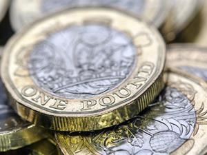 New one pound coins_money_wages