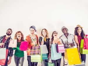 Young people Gen Z millennials with shopping bags high street