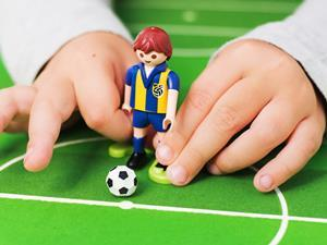 Child playing table football_World cup