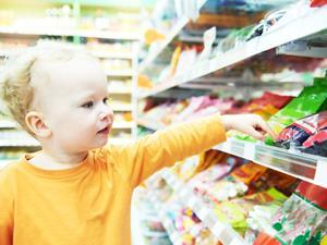 child in supermarket sweets