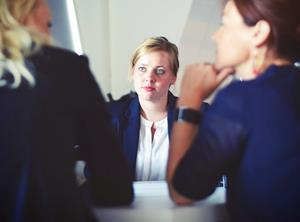 Young woman being interviewed in an office