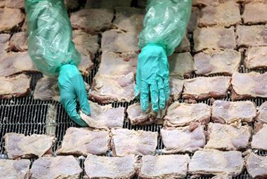 poultry facing backlash from green campaigners, raw chicken in factory
