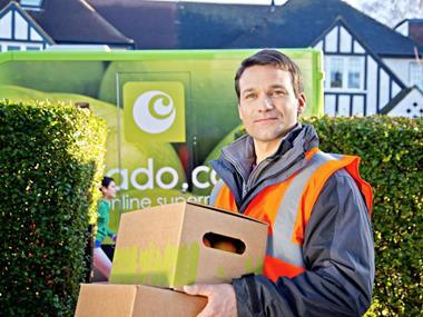 Ocado driver with veg box