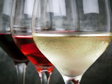 focus on wine, glass of wine red white and rose
