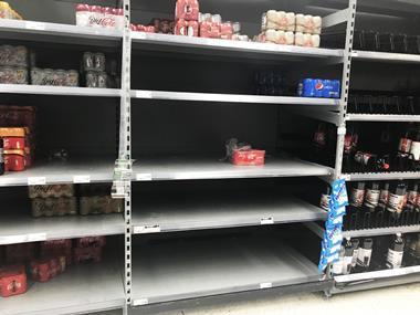 Asda near-empty soft drink shelves